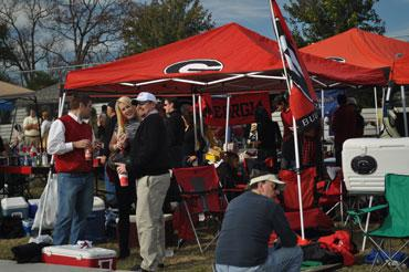 UGA supporters mill about their tents chatting with people while they prepare for the game. & UGA-Tech Tailgating - Atlanta Magazine