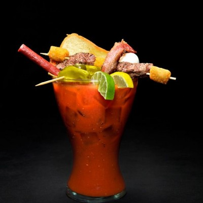 The Nook on Piedmont Park: Yes, that is a meat straw (a hollow Slim Jim) poking out of the city's most outrageous Bloody Mary. Absolut Peppar, bacon, and a skewer of steak and tater tots help complete this meal in a thirty-two-ounce glass. thenookatlanta.com