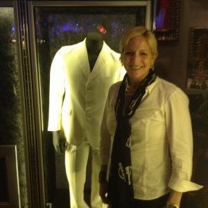 Elise Tedeschi strikes a pose in front of John Lennon's white suit.