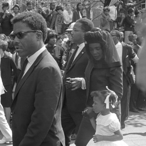 Bernice King and her mother walk in her father's funeral procession, 1968