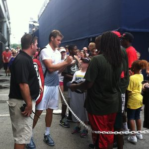 Ryan Harrison signs autographs at the Atlanta Open