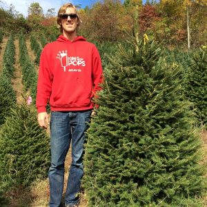 Nick Carse poses with a Norway Spruce on a West Jefferson, North Carolina farm.