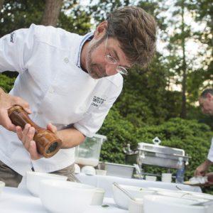 Chris Hastings prepares food at the 2013 AFWF