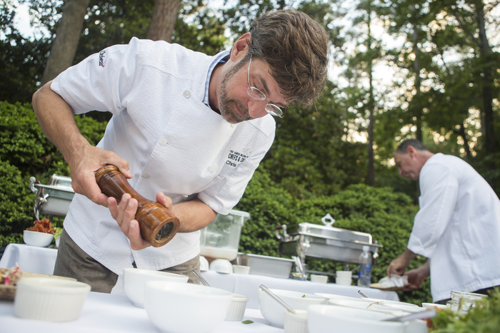 Chris Hastings prepares food at the 2013 AFWF