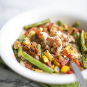 Garnish & Gather's pan-seared shrimp with summer vegetables and grits, created by Kevin Gillespie