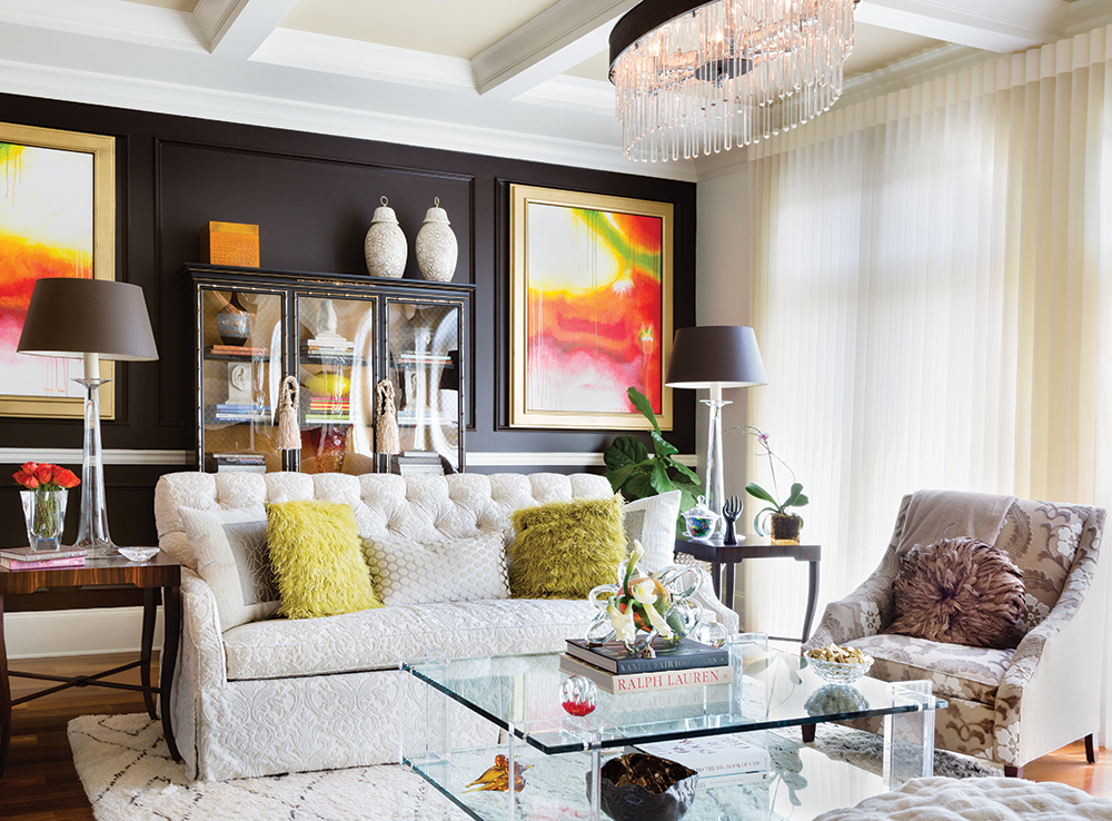 Dark Chocolate Walls Create Depth In The Living Room While Crystal And Glass Accessories Keep