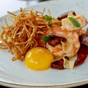 Garlic shrimp with pickled choriizo, soft yolk, and shoestring potatoes