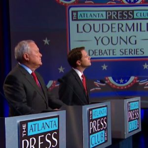 Andrew Hunt, Nathan Deal, Jason Carter, and moderator Brenda Wood at the debate, October 19, 2014.