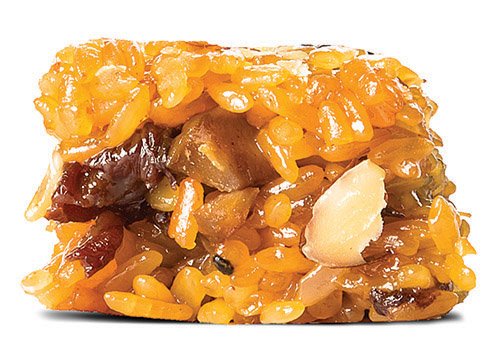Yaksik  Expect a mild sesame flavor in this chewy rice cake made with nuts and raisins. 54 cents