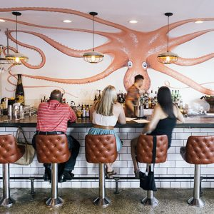 The mural at Lusca references Octopus Bar, its sister restaurant in East Atlanta