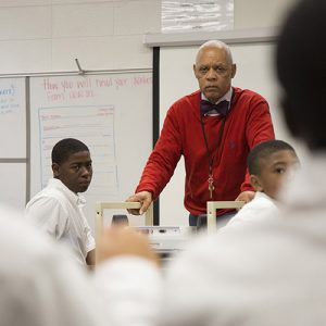 Principal Frederick Birkett meets with the seventh grade boys at Utopian to ask about their study habits.