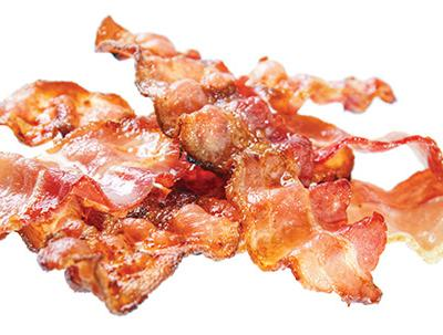 *** Local Caption *** Fried bacon rashers , isolated on white background