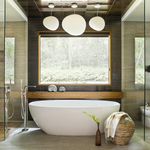 Glass walls separate this contemporary master bath into three areas while allowing all the materials to show. A blend of tiles and wood keeps the palette neutral but with texture.