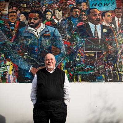 Tom Houck before a mural at the MLK Jr. National Historic Site