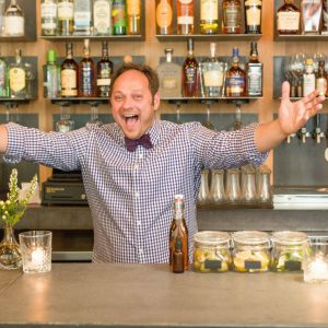 Billy Streck behind the bar at Grain