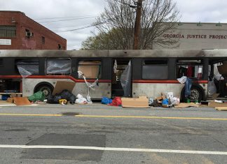 """A burned out bus, part of a set for """"Cordon"""" filming in Atlanta on Edgewood Avenue"""