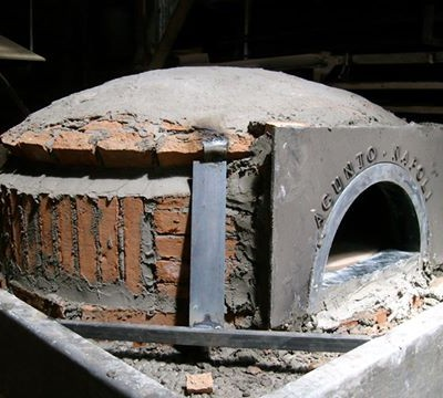 Vero's 6,800-pound, wood-burning pizza oven