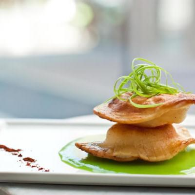 Indian-spiced potato pierogies with English peas and a sweet pea emulsion