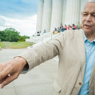 "Julian Bond stands on the steps of the Lincoln Memorial during the making of the documentary ""Julian Bond: Reflections from the Frontlines of the Civil Rights Movement."""
