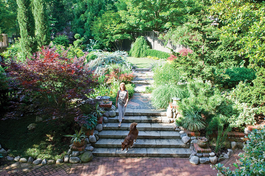 A little smoke and mirrors make this Ansley Park garden a Zen ...
