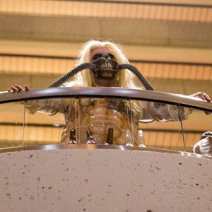 A Dragon Con attendee dressed as Immortan Joe from Mad Max: Fury Road observes the crowd the Marriott Marquis' Pulse Loft