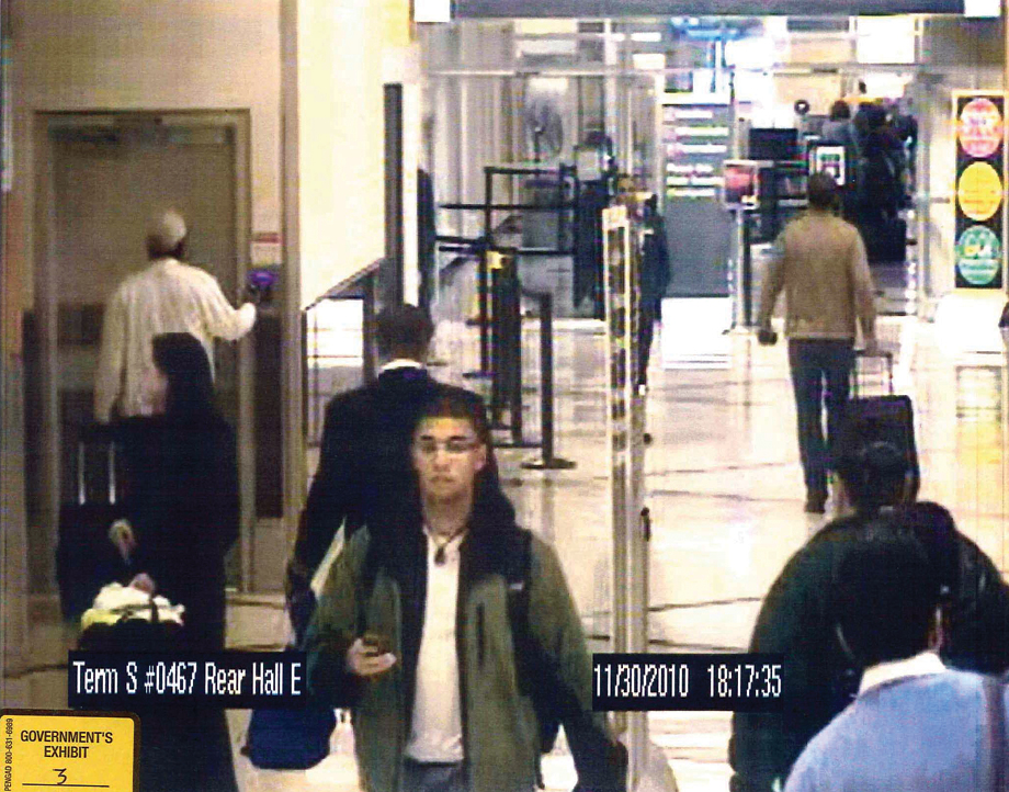 Surveillance footage showing Samuels (circled below) using his ID to smuggle money and guns into the airport