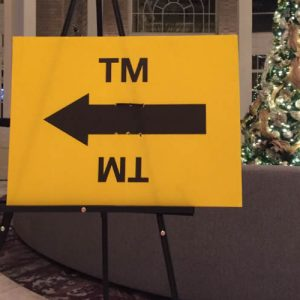 Inside the Georgian Terrace lobby, a sign points the way to the True Memoirs of an International Assassin wrap party.