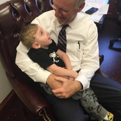 Rep. Allen Peake holds Hawk Harrison, a Hall County resident who suffers from seizures and needs cannabis oil for treatment, inside his office at the Capitol.