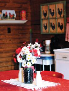 An old-fashioned Formica-topped dining table welcomes guests to their room.