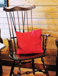 Well-used rocking chairs invite guests to relax after farm chores.