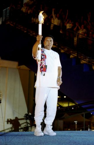 19 Jul 1996: Muhammad Ali holds the torch before lighting the Olympic Flame during the Opening Ceremony of the 1996 Centennial Olympic Games in Atlanta, Georgia.