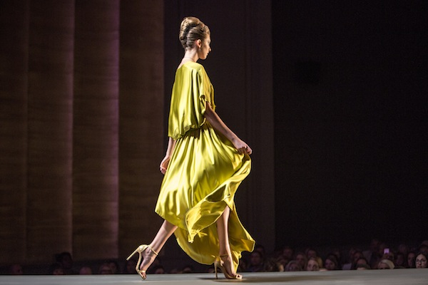 A silk look by Paola Safie gliding down SCAD's runway in May