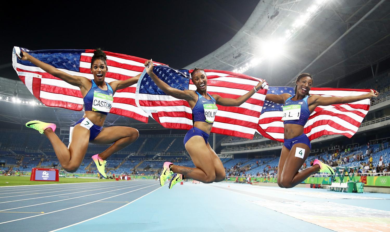 Kristi Castlin, Brianna Rollins, and Nia Ali celebrate after the Women's 100m Hurdles Final