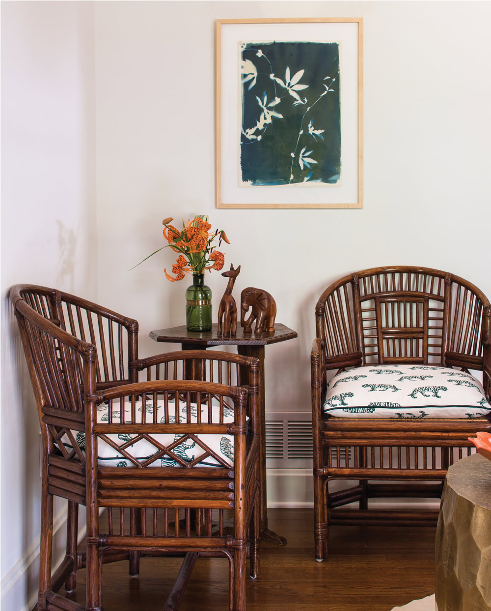 The tiger print on the chairs is by Athens-based Block and Brayer. Foliage paintings are by local artist Rinne Allen.