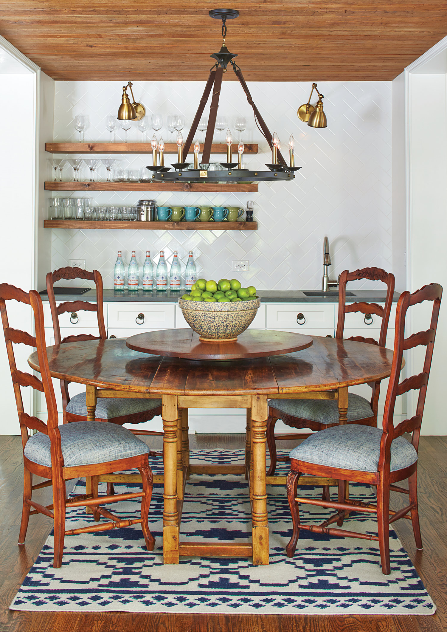 Open shelving helps turn the breakfast room into a space for casual entertaining.