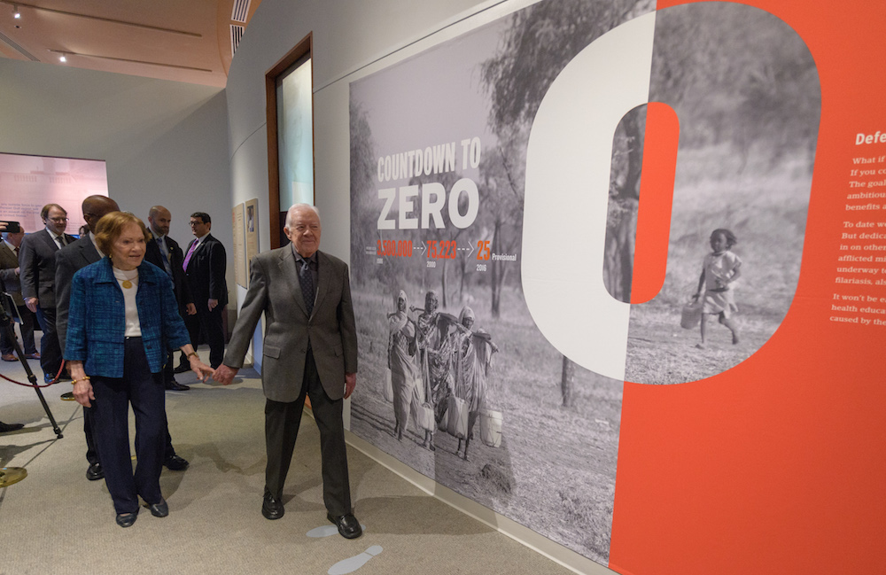 """President Carter and his wife Rosalyn Carter enter the """"Countdown to Zero"""" exhibition at the Carter Presidential Library and Museum."""