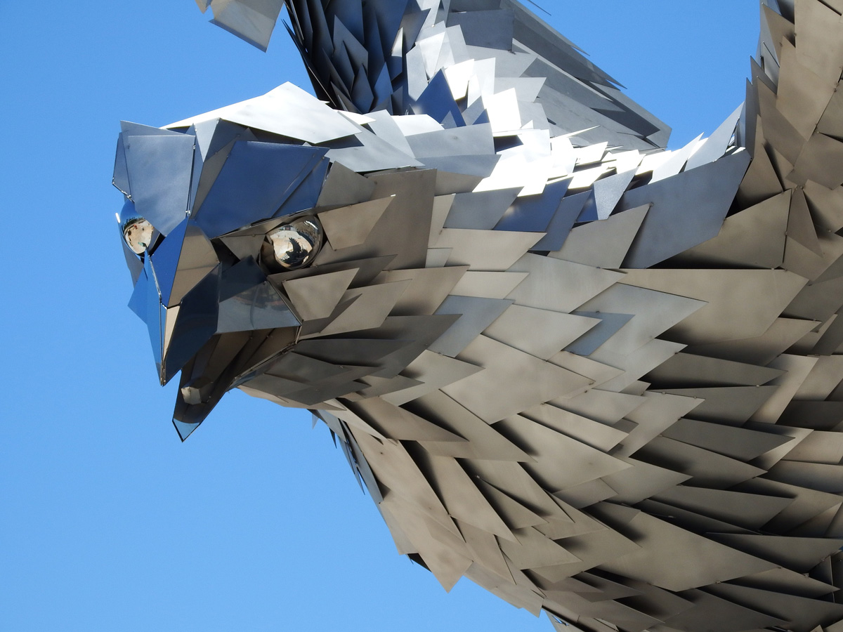 A Giant Stainless Steel Falcon Is Rising Up In Front Of