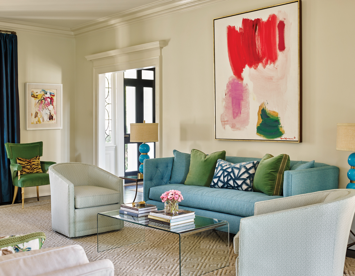 A Vibrant Blue Tufted Sofa Holds Court In The Living Room Large Scale Painting Above Is By Abstract Expressionist Hans Hofmann