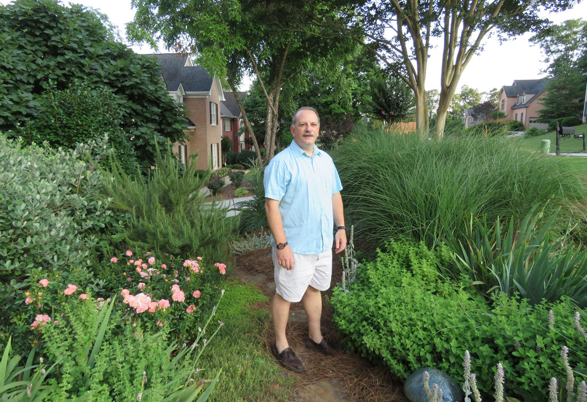 Creative environments landscape co edible gardens - Chip Wilmot Stands In His Lilburn Home S Edible Landscape