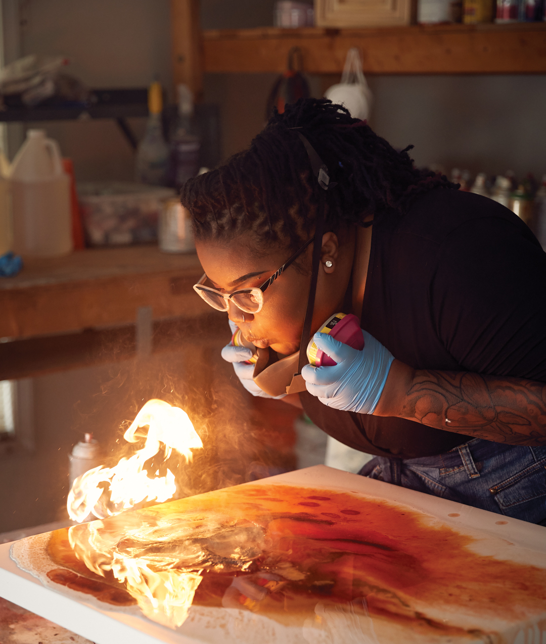 Flame thrower: Lawrenceville artist Erica Elle uses a blowtorch to create her vibrant paintings