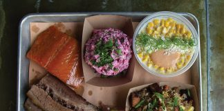 A plate of salmon, brisket, and three delicious sides