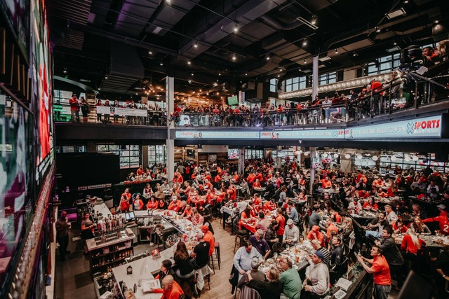 Dozens of UGA fans watching the Georgia-Florida game at the Battery