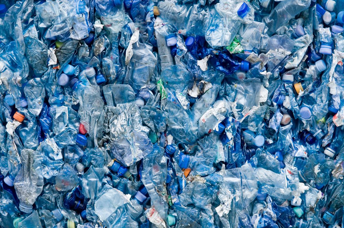 Recycling bottles smashed together