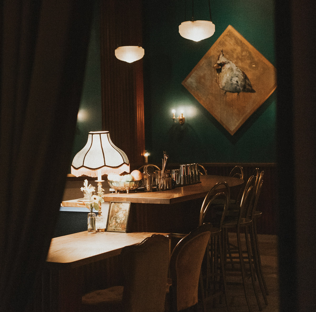 Peeking through the curtain to empty tables at the Cardinal