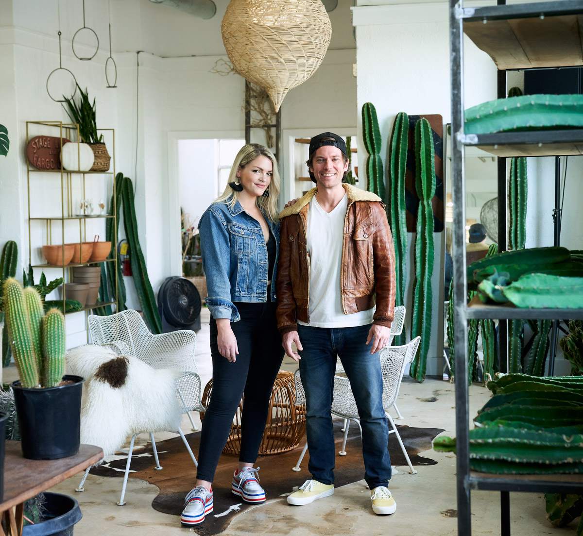 Shelby and Will Perry standing among dozens of cacti