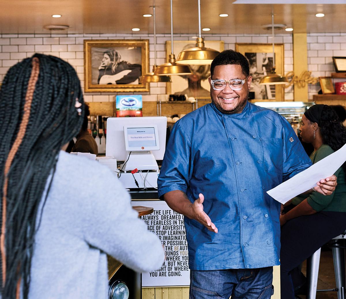 Chef Sammy Davis greeting a customer