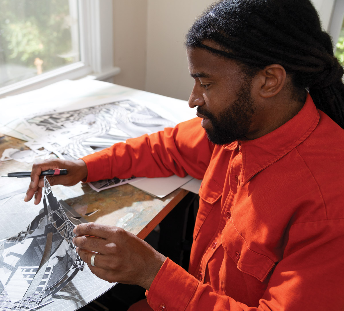 Eric Mack creating paper cutouts for his highly architectural paintings