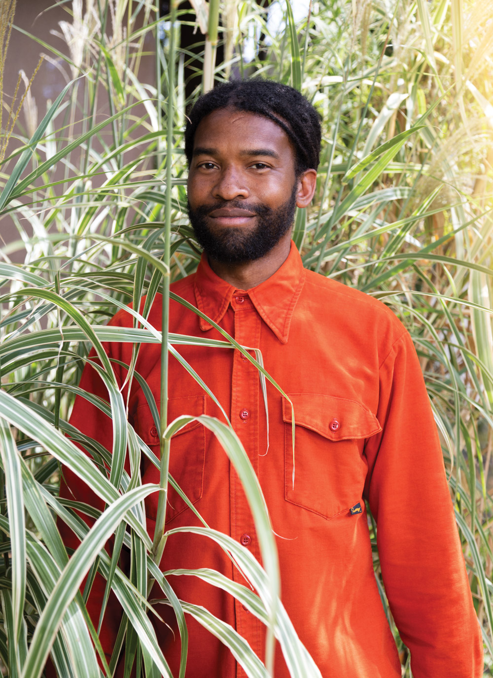 Eric Mack in his home garden, which doubles as a studio space
