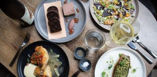 Redbird review: Chicken-liver mousse, pan-roasted fish, and crushed pecan ice on a table