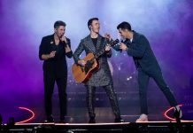 Nick Jonas, Kevin Jonas, and Joe Jonas perform at The Forum on December 14, 2019 in Inglewood, California